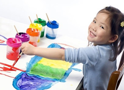 Child smiling while painting